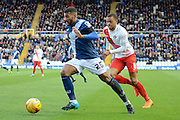Birmingham City midfielder David Davis bursts forward watched by Charlton Athletic midfielder Jordan Cousins during the Sky Bet Championship match between Birmingham City and Charlton Athletic at St Andrews, Birmingham, England on 21 November 2015. Photo by Alan Franklin.