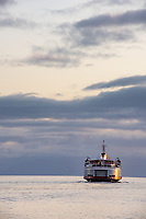 The Coho ferry sails into the sunset from the Inner Harbour of Victoria, BC.