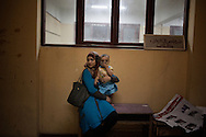 Egypt, Cairo: An Egyptian woman waits with her son outside  a polling station   in Cairo on May 24, 2012 during historic presidential elections, the first since a popular uprising toppled Hosni Mubarak.ph Christian Minelli.