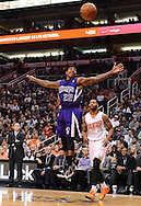 Nov 20, 2013; Phoenix, AZ, USA; Sacramento Kings guard Isaiah Thomas (22) looses control of the ball against Phoenix Suns forward Marcus Morris (15) in the first half at US Airways Center. Mandatory Credit: Jennifer Stewart-USA TODAY Sports