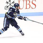 Jake Rutt #4 of the Maine Black Bears follows through on a shot during the game at Matthews Arena on February 22, 2014 in Boston, Massachusetts. (Photo by Elan Kawesch)
