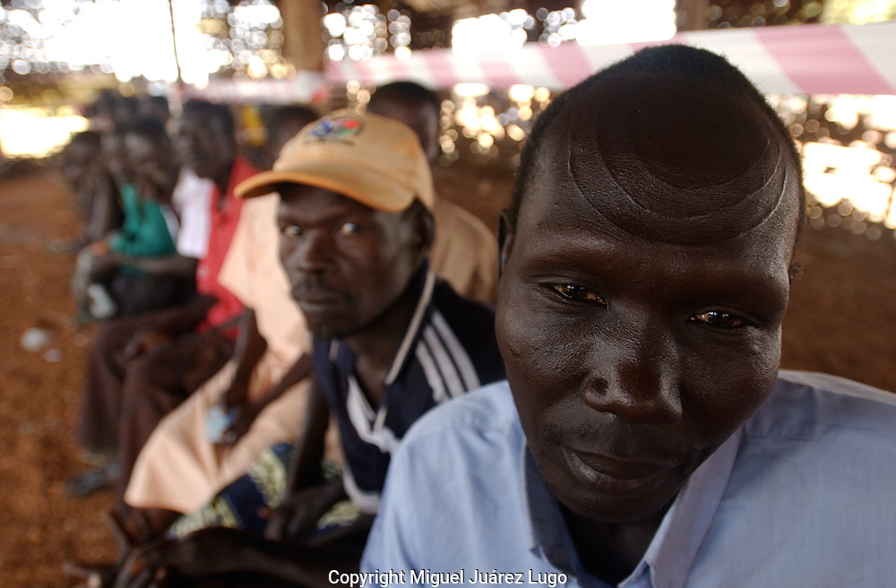 Venesio Lodu Jenebo, waits along other members from the Mundare tribe to cast their vote in a polling station in the town of Kuda,   South Sudan. (PHOTO: MIGUEL JUAREZ LUGO)