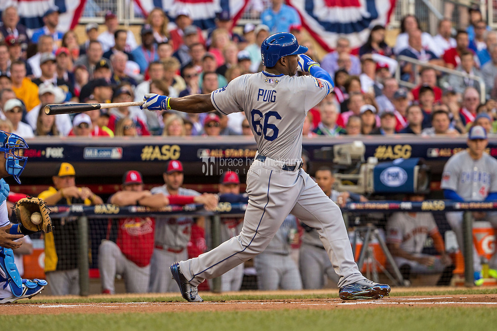 MINNEAPOLIS, MN- JULY 15: National League All-Star Yasiel Puig #66 of the Los Angeles Dodgers during the 85th MLB All-Star Game at Target Field on July 15, 2014 in Minneapolis, Minnesota. (Photo by Brace Hemmelgarn) *** Local Caption *** Yasiel Puig