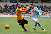 Derby County midfielder Jacob Butterfield skips past Wolverhampton Wanderers midfielder Nathan Byrne  during the Sky Bet Championship match between Wolverhampton Wanderers and Derby County at Molineux, Wolverhampton, England on 27 February 2016. Photo by Alan Franklin.