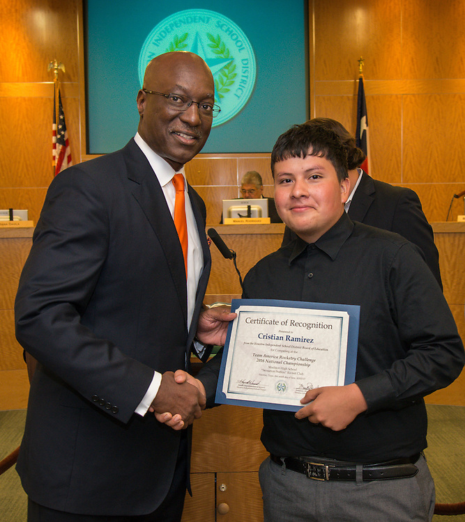Houston ISD Interim Superintendent Ken Huewitt and Cristian Rameriz pose for a photograph during a meeting of the Board of Trustees, June 9, 2016.