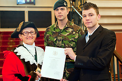 British Army Enlistments Oath of Allegiance held at the Mansion House Doncaster South Yorkshire. recruit Louis Kaye from Goole with Deputy Mayor of Doncaster, Councillor Patricia Schofield  Sjt David Hack of 3 Rifles with ACIO (Army Careers Information Office) Doncaster 14 January 2010.Images © Paul David Drabble