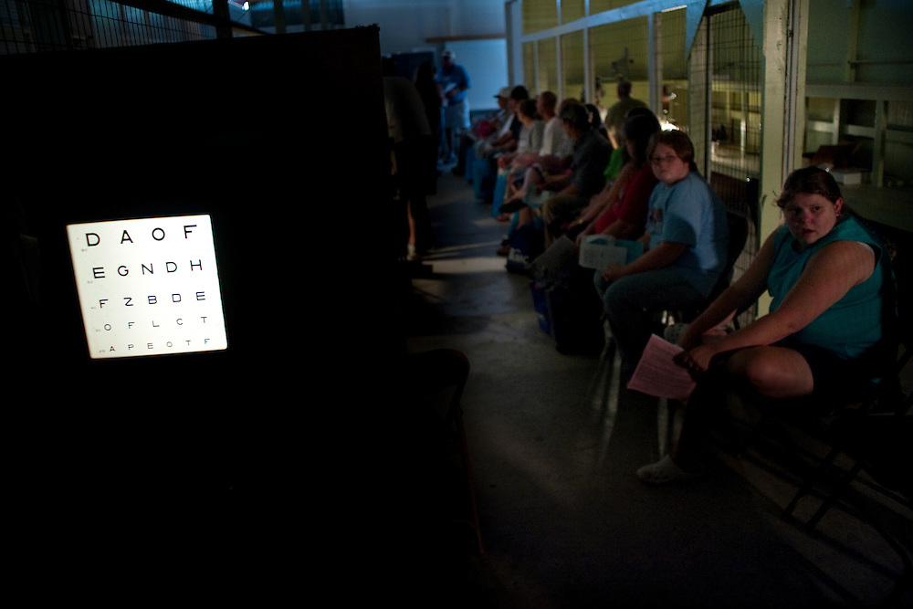 Patients wait in the converted poultry barn for their turn to see the optometrists...Remote Area Medical (RAM) is a non-profit, volunteer, airborne relief corps dedicated to serving mankind by providing free health care, dental care, eye care, veterinary services, and technical and educational assistance to people in remote areas of the United States and the world.