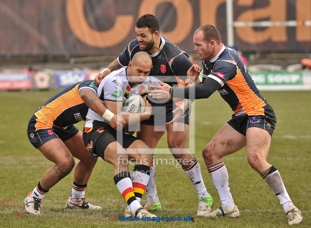 Picture by Richard Land/Focus Images Ltd +44 7713 507003.17/03/2013.Keith Lulia of Bradford Bulls is wrapped up by the  Hull Kingston Rovers defence during the Super League match at Odsal Stadium, Bradford.