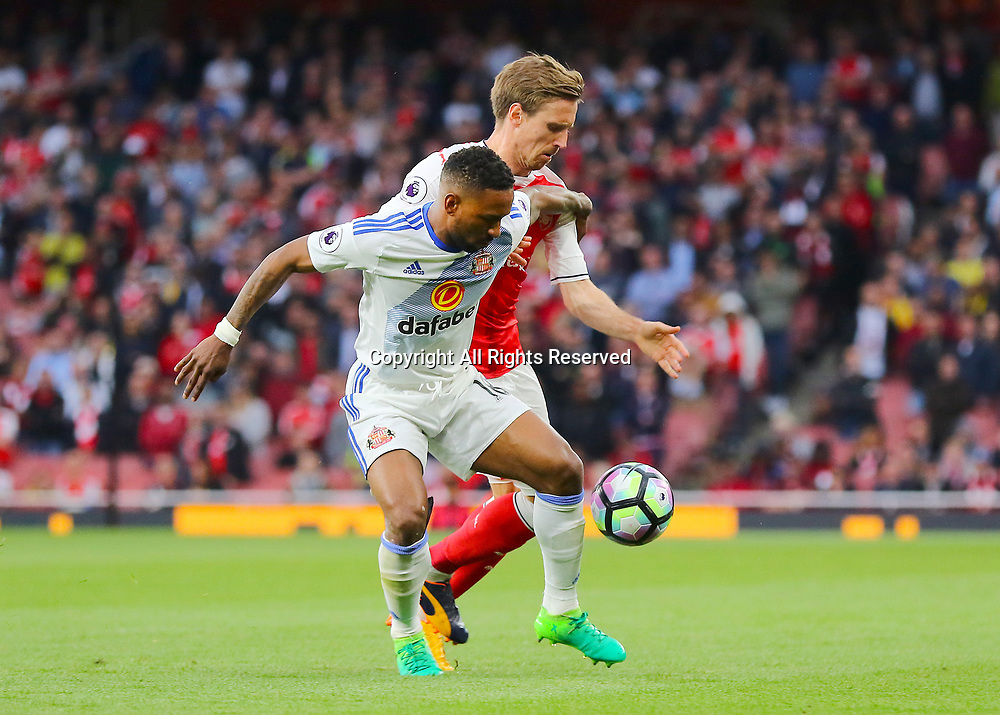 May 16th 2017, Emirates Stadium, Highbury, London, England;  EPL Premier League football, Arsenal FC versus Sunderland; Jermain Defoe of Sunderland and Nacho Monreal of Arsenal battle for possession