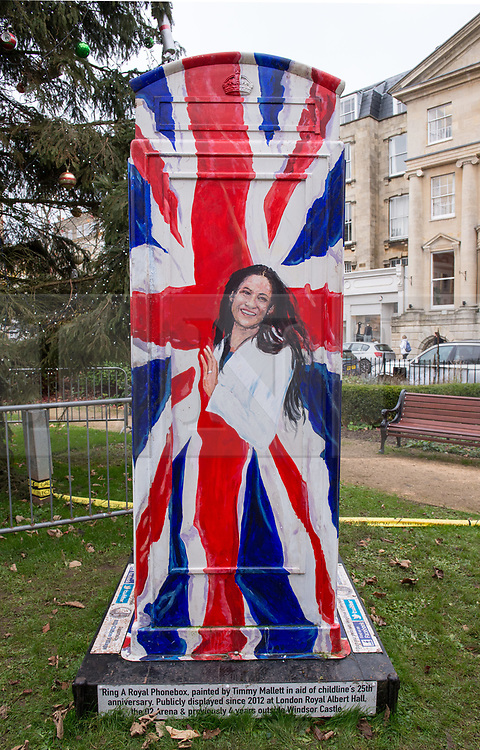 © Licensed to London News Pictures. 05/12/2017. Bristol, UK. A new painting by artist Timmy Mallett of MEGHAN MARKLE, complete with engagement ring and wrapped in the Union Jack, on the painted Ring a Royal Phonebox at The Mall Gardens in Clifton Village, Bristol, following the recent announcement of the engagement between Prince Harry and Meghan Markle. Artist Timmy Mallett first painted the phone box in 2012 in aid of 25th Childline Anniversary and it has been on public display since 2012 at London's Royal Albert Hall, the O2 Arena and for the last 4 years outside Windsor Castle. The colourful phone box features Her Majesty the Queen, Prince Harry striking the classic Usain Bolt lightning pose, and The Duchess of Cambridge on her mobile with a pram. Photo credit: Simon Chapman/LNP