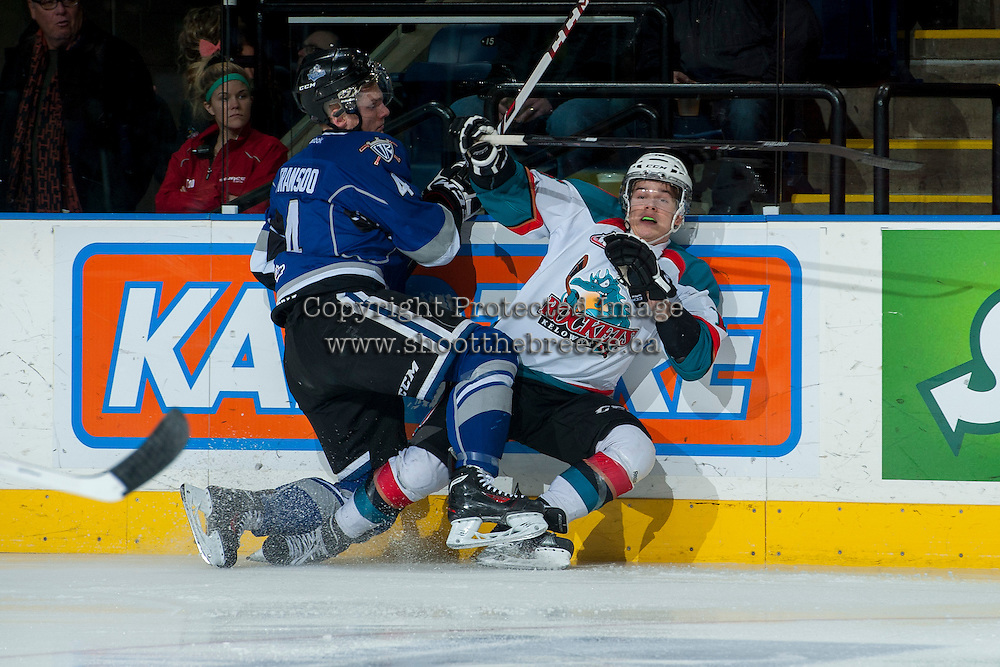 KELOWNA, CANADA -FEBRUARY 8: Jordan Fransoo #4 of the Victoria Royals checks Kris Schmidli #16 of the Kelowna Rockets at the boards during first period on February 8, 2014 at Prospera Place in Kelowna, British Columbia, Canada.   (Photo by Marissa Baecker/Getty Images)  *** Local Caption *** Jordan Fransoo; Kris Schmidli;
