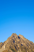 Top of Mount Stuart against blue sky at sunset Central Cascades Washington USA.
