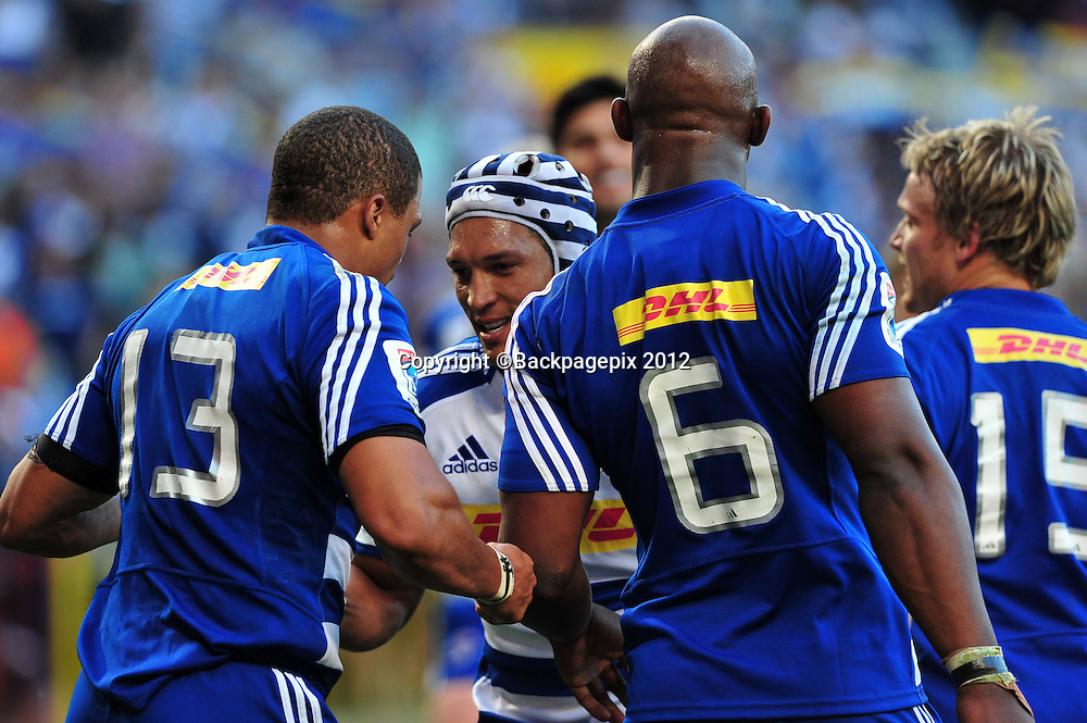 Gio Aplon and Juan de Jongh of the Stormers celebrate after de Jongh scored a try during the Stormers 2013 Super Rugby game between the Stormers and the Sharks at Newlands Rugby Stadium on 13 April 2013 ©Ryan Wilkisky/BackpagePix
