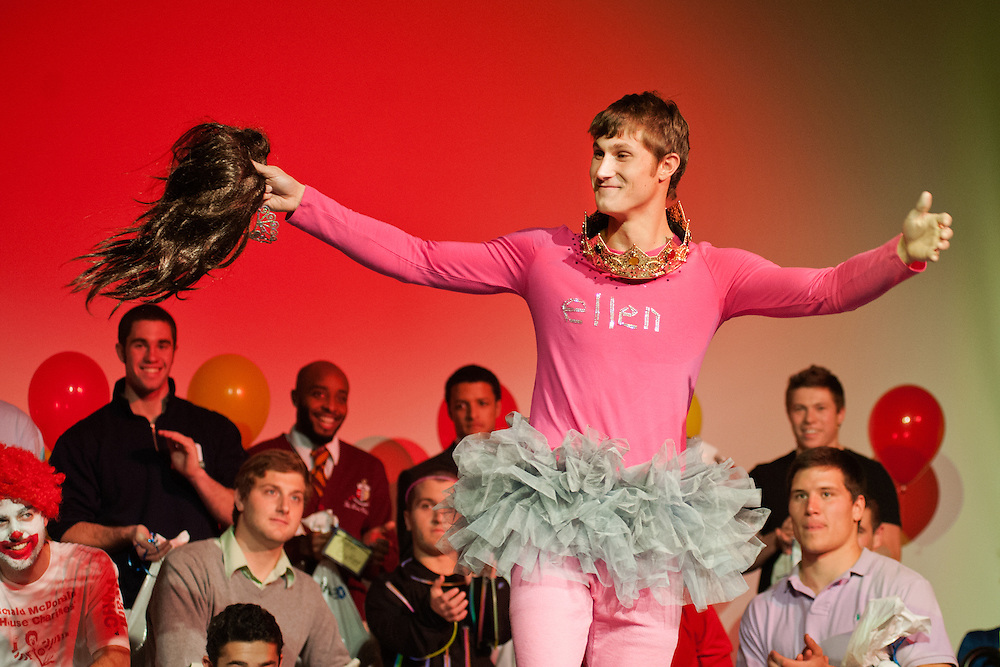 Eric Horton removes his wig in celebration as his fellow contestants look on during the first annual Mr. University Pageant. The pageant, which was organized by Alpha Delta Pi was held as a fundraiser for the Ronald McDonald House Charities of central Ohio and featured 19 male students who competed in swimsuit, OU trivia and formal wear contests. Horton was selected as the winner based on his performances in all three categories.  Photo by: Ross Brinkerhoff.