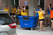 Student volunteers greet a new student at Susan B. Anthony Hall on move-in day for new students at the University of Rochester on Tuesday, August 25, 2015.