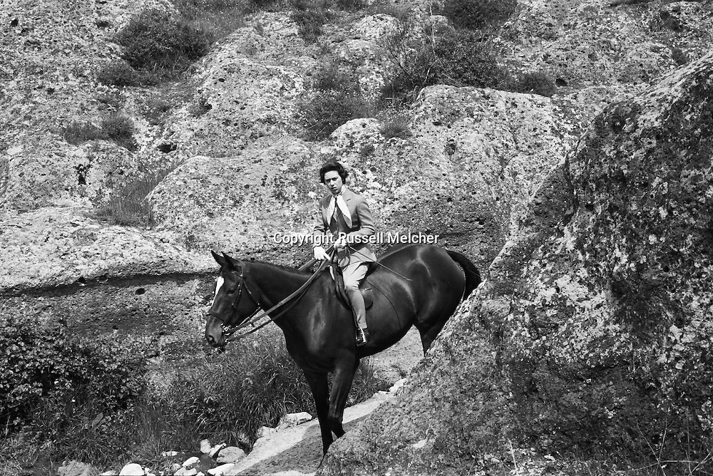 Princess Anne riding a horse outside of Rome during the same visit.<br />