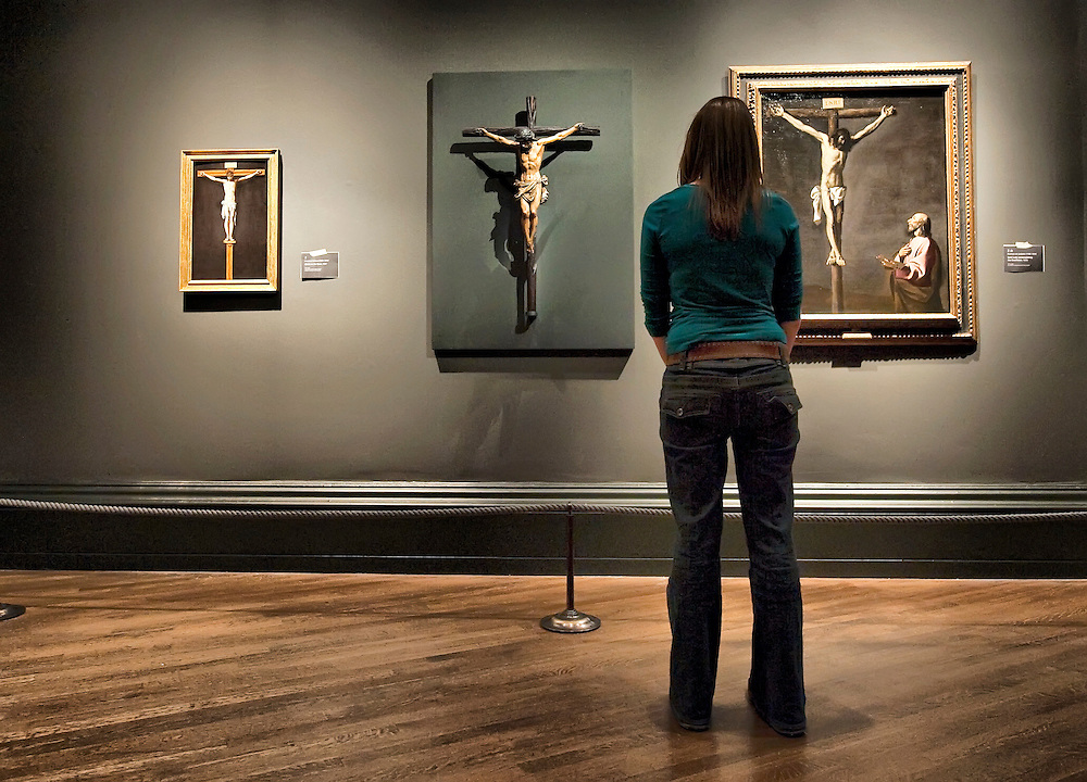 LONDON, ENGLAND - OCTOBER 16: A National Gallery employee stands in front of three paintings  of Crucifixion by (L-R) Francisco Paceco,  Juan de  Mesa and Francisco de Zurbaran at 'The Sacred Made Real Exhibition' at the National Gallery  on October 16, 2009 in London, England. The Exhibition running from October 21 to January 24, 2010 includes masterpieces by Velasquez and Francisco de Zurbaran which are displayed for the very first time alongside Spain's polyccrome painted sculptures...***Agreed Fee's Apply To All Image Use***.Marco Secchi /Xianpix. tel +44 (0) 771 7298571. e-mail ms@msecchi.com .www.marcosecchi.com