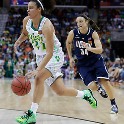 April 7, 2013; New Orleans, LA, USA; Notre Dame Fighting Irish guard Kayla McBride (21) dribbles against Connecticut Huskies guard Kelly Faris (34) during the first half in the semifinals during the 2013 NCAA womens Final Four at the New Orleans Arena. Mandatory Credit: Derick E. Hingle-USA TODAY Sports