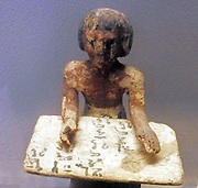 Egyptian tomb figure depicting a scribe.