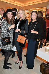 Left to right, AMBRA MEDDA, PRISCILLA WATERS and ALLEGRA DONN at the Roger Vivier 'The Perfect Pair' Frieze cocktail party celebrating Ambra Medda & 'Miss Viv' at the Roger Vivier Boutique, Sloane Street, London on 15th October 2014.