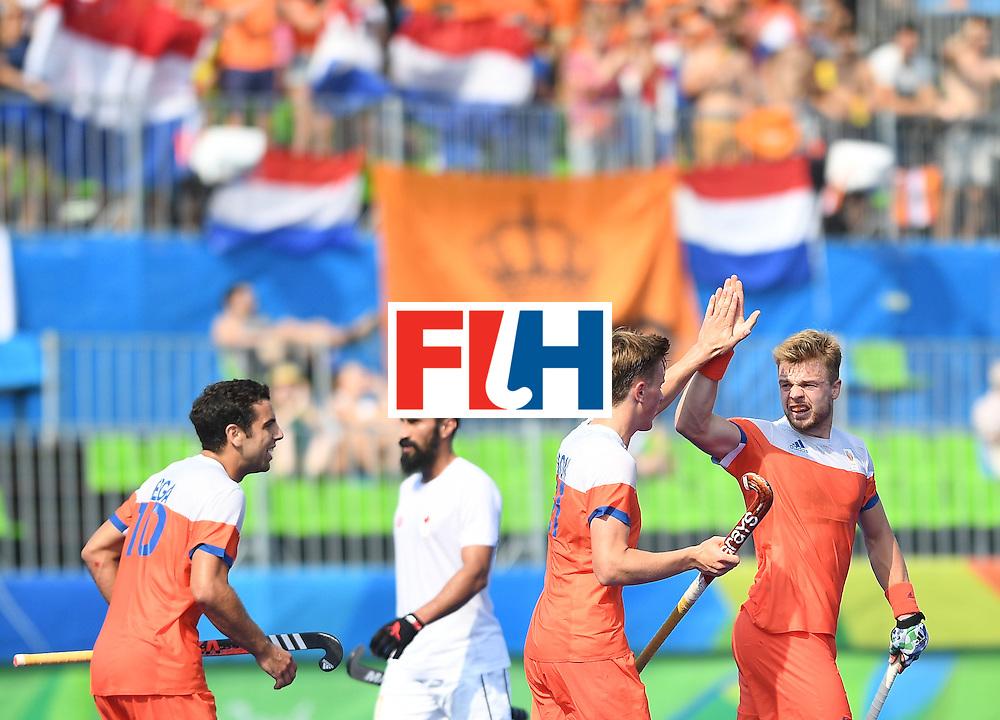 Netherland's Mink van der Weerden (R) celebrates scoring a goal during the men's field hockey Netherlands vs Canada match of the Rio 2016 Olympics Games at the Olympic Hockey Centre in Rio de Janeiro on August, 9 2016. / AFP / MANAN VATSYAYANA        (Photo credit should read MANAN VATSYAYANA/AFP/Getty Images)