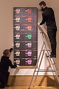 "UNITED KINGDOM, London: 1 February 2016 Bonham's staff members make the final adjustments at Bonhams London of Andy Warhol's ""Fourteen Small Electric Chairs"" (estimated to be worth £4,000,000 - 6,000,000) which forms part of the Post-War Contemporary Art Sale which opens 11th of February 2016. It is the first time the lot will come to the market publicly in 20 years. Rick Findler  / Story Picture Agency"