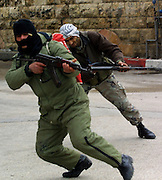 EDITORS NOTE: THIS IS A SEQUENCE.Palestinian gunmen shooting towards Israeli tanks and forces in the center of Ramallah Friday March 29,2002. The gunman with the Kafiya is seen  shot by Israeli forces. (Photo by Heidi Levine/Sipa Press).