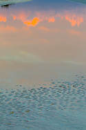 Rippled sand and and tide pool reflections at low tide, sunset, Gulf of Mexico, Sanibel Island, Florida