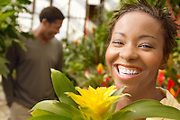 Smiling Woman in a Greenhouse