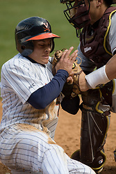 Virginia Cavaliers INF Greg Miclat (2) is tagged out at home by Boston College catcher Tony Sanchez.  The #19 ranked Virginia Cavaliers baseball team defeated the Boston College Golden Eagles 5-4 in 10 innings at the University of Virginia's Davenport Field in Charlottesville, VA on March 22, 2008.