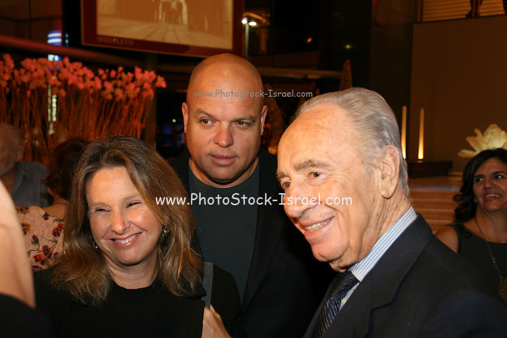 Shimon Peres member of parliament and Vice Premier, ex prime minister of Israel and member of Kadima political party, and Shari Arison major share holder in Bank Hapoalim with her husband Ofer Glazer, who recently was found guilty of sexual harassment and sentenced to 6 months imprisonment, October 2006