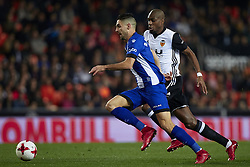 January 17, 2018 - Valencia, Valencia, Spain - Ruben Sobrino (L) of Deportivo Alaves competes for the ball with Kondogbia of Valencia CF during the Copa del Rey quarter-final first leg  game between Valencia CF and Deportivo Alaves at Mestalla stadium on January 17, 2018 in Valencia, Spain  (Credit Image: © David Aliaga/NurPhoto via ZUMA Press)
