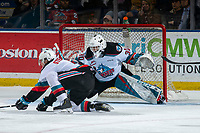 KELOWNA, BC - JANUARY 8:  Devin Steffler #4 tries to block a shot as Roman Basran #30 of the Kelowna Rockets defends the net against the Victoria Royals at Prospera Place on January 8, 2020 in Kelowna, Canada. (Photo by Marissa Baecker/Shoot the Breeze)