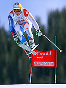 SHOT 12/1/11 12:55:20 PM - Swiss skiier Vitus Lueoend launches himself off the Red Tail jump during men's downhill training on the Birds of Prey course at the Audi FIS World Cup on December 1, 2011 in Beaver Creek, Co. (Photo by Marc Piscotty / © 2011)