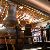 FREE TO USE PHOTOGRAPH.....12.08.10.   The Famous Grouse today celebrated 30 Years as Scotland's best loved whisky after holding the No1 spot as the top selling whisky since 1980 with over 800 million bottles of The Famous Grouse sold globally since 1980....Visitors tour the distillery<br /> For further info contact The Big Partnership (Helen Balls or Mhairi De Luca) on 0131 555 5522<br /> Picture by Graeme Hart.<br /> Copyright Perthshire Picture Agency<br /> Tel: 01738 623350  Mobile: 07990 594431