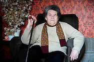 Salvadora Arranz, 87 years old, while she sits down, waits for her two sons phone calls from a Spanish prison more than 800 kilometers away at the Basque city of Irun on February 19th, 2009. Antxon and Txomin Troitiño are imprisoned in two Spanish prisons more than 800 km far from their home. Salvadora receives a weekly call timed 4 minutes and 58 seconds from each son. (Ander Gillenea / Bostok Photo)