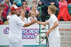 LIVERPOOL, ENGLAND - Thursday, June 18, 2009: Liam Broady (GBR) and Vince Spadea (USA) during Day Two of the Tradition ICAP Liverpool International Tennis Tournament 2009 at Calderstones Park. (Pic by David Rawcliffe/Propaganda)