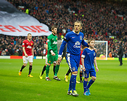 MANCHESTER, ENGLAND - Sunday, February 10, 2013: Former Manchester United player Everton's captain Phil Neville walks out to face his old side before the Premiership match at Old Trafford. (Pic by David Rawcliffe/Propaganda)