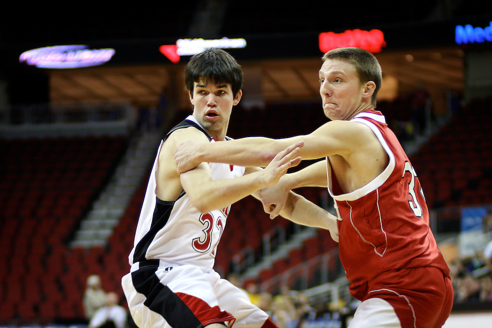 Ross Preston '10 struggles for an open pass against Monmouth Guard Fletcher Morgan during the first half of Tuesday's game.
