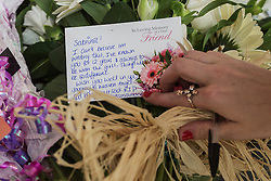 © licensed to London News Pictures. London, UK 27/09/2013. Flowers left at Sabrina Moss's funeral at St Alphage Church in Burnt Oak, north London on Friday, 27 September 2013. Nursery teacher Sabrina Moss was shot dead in Kilburn while out celebrating her 24th birthday on Saturday 24 August 2013. Photo credit: Tolga Akmen/LNP