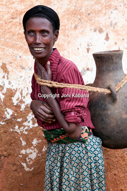 Women carry heavy clay pots to fetch water when water flows in the streams. This creates many health issues such as prolapse conditions. Lalo lives in Gimbie, Ethiopia