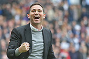 A delighted Derby County Manager Frank Lampard celebrates reaching the play-offs during the EFL Sky Bet Championship match between Derby County and West Bromwich Albion at the Pride Park, Derby, England on 5 May 2019.