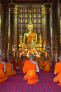 Young novice monks in meditation at Wat Nong, Luang Pranbang, Laos.