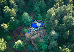 Licensed to London News Pictures. 20/05/2017. Coldharbour, UK. The 'Protection Camp' on Leith Hill.  Protestors have constructed and occupied a fort and some trees on the site of a proposed oil well drilling rig. Planning permission for 18 weeks of exploratory drilling was granted to Europa Oil and Gas in August 2015 after a four-year planning battle. The camp was set up by protestors in October 2016 in order to draw  attention to plans to drill in this Area of Outstanding Natural Beauty (AONB) in the Surrey Hills. The camp has received support from the local community.  Photo credit: Peter Macdiarmid/LNP