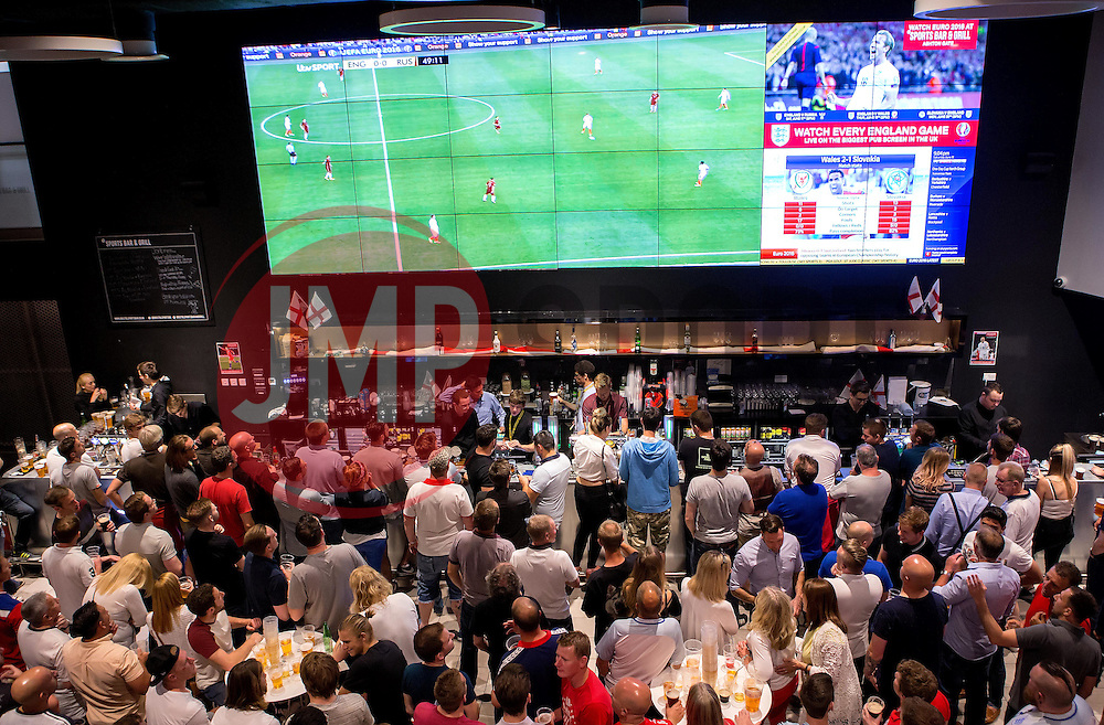 Fans watch the game between England and Russia in the Sports Bar and Grill at Ashton Gate - Mandatory by-line: Robbie Stephenson/JMP - 11/06/2016 - FOOTBALL - Ashton Gate - Bristol, United Kingdom  - England vs Russia - UEFA Euro 2016