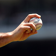 A baseball player holding a baseball during warm up before the New York Mets V Chicago Cubs Baseball game at Citi Field, Queens, New York. USA. 15th June 2013. Photo Tim Clayton