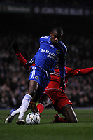 Photo: Tony Oudot/Sportsbeat Images.<br /> Chelsea v Liverpool. Carling Cup, Quarter Final. 19/12/2007.<br /> Salomon Kalou of Chelsea is challenged by Ryan Babel of Liverpool