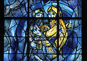 Abraham and Melchisedec, stained glass window, 1974, by Marc Chagall, 1887-1985, with the studio of Jacques Simon, in the axial chapel of the apse of the Cathedrale Notre-Dame de Reims or Reims Cathedral, Reims, Champagne-Ardenne, France. The cathedral was built 1211-75 in French Gothic style with work continuing into the 14th century, and was listed as a UNESCO World Heritage Site in 1991. Picture by Manuel Cohen