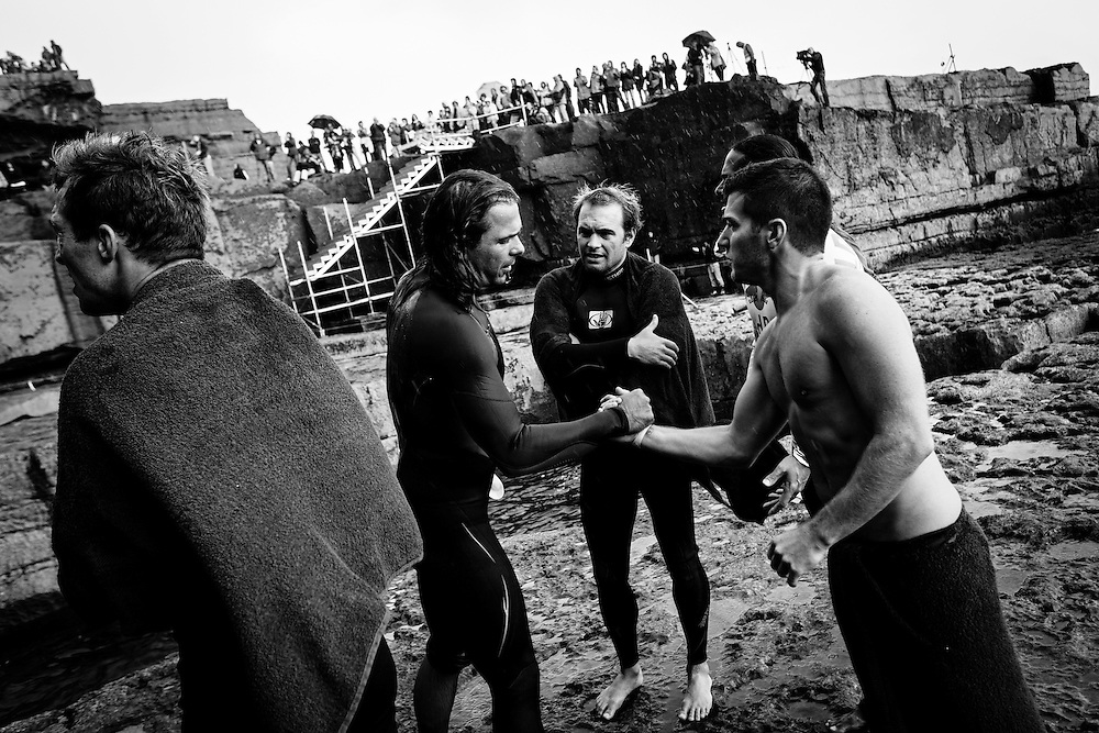 Bulgarian diver, Todor Spasov, gets congratulated for a dive on Inis Mor, Ireland. The Red Bull Cliff Diving World Series 2012. 03 August 2012