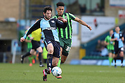 Lyle Taylor forward for AFC Wimbledon (33) and Wycombe Wanderers defender Joe Jacobson (3) battle for the ball during the Sky Bet League 2 match between Wycombe Wanderers and AFC Wimbledon at Adams Park, High Wycombe, England on 2 April 2016. Photo by Stuart Butcher.